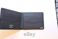 29327d39650 Louis Vuitton Men S Slender Wallet In Taiga Leather With Hot Stamp ...